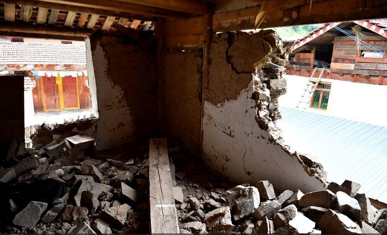亞錄寨受損房屋。(視覺中國)