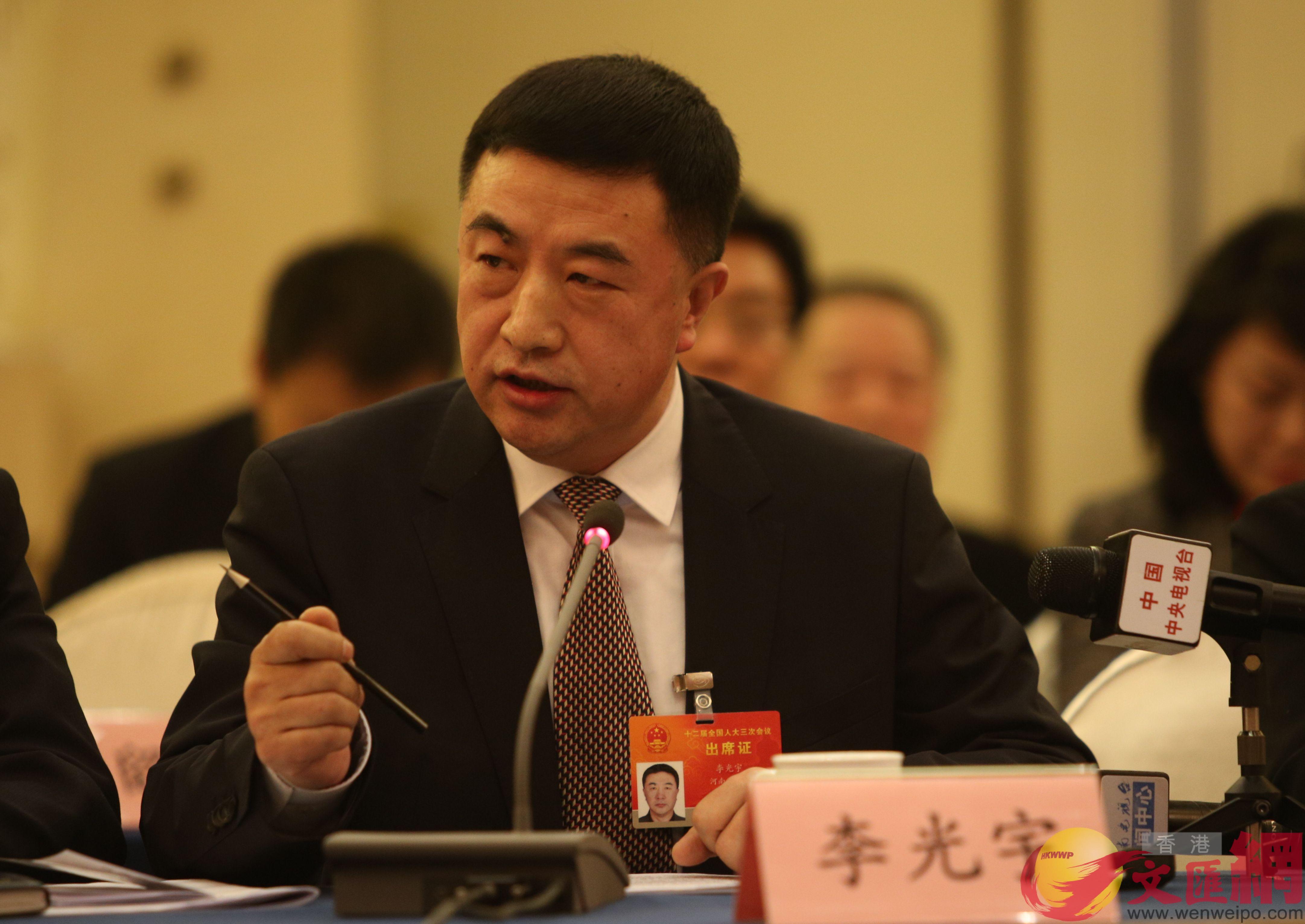 全國人大代表、宇華教育集團董事長李光宇。