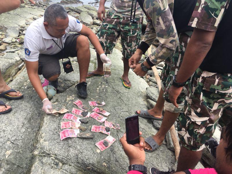 11日,泰方在打撈出的中國遇難者遺體的衣服內發現了人民幣。(環球網)
