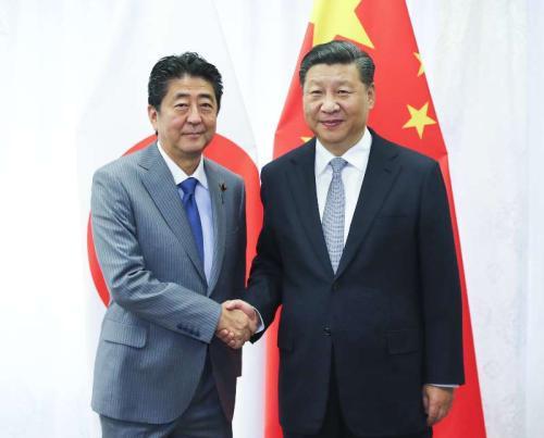 9月12日,國家主席習近平在符拉迪沃斯托克會見日本首相安倍晉三。新華社