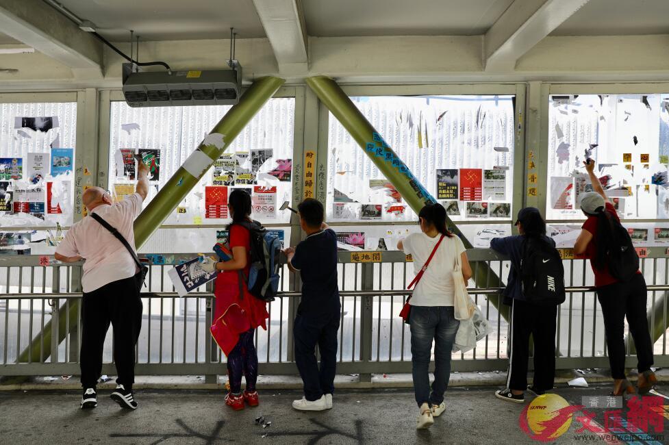 港人自發清理「連儂墻」,斥責暴徒搞亂香港。